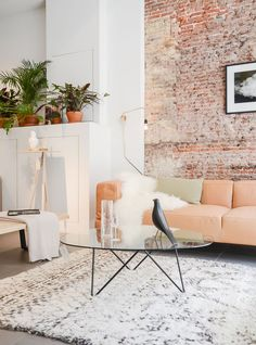 rugs in the home | living room | texture | home decor | design your space | exposed brick wall
