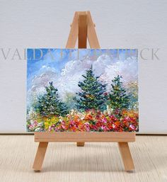 Three pine trees among a field of flowers. This small miniature is 3x4 inches, which stands on a wooden easel that is included.  It can be displayed just about anywhere and is also great for a small space apartment, mantle or wherever a touch of color is needed.  As a gift , it is truly perfect for any occasion at any time.  I prefer to ship my art USPS priority mail, which includes insurance and routing number.  http://www.etsy.com/shop/valdasfineart
