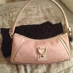 Pink Gucci Handbag with Gold Hardware 100% authentic Gucci handbag is perfect condition as shown. Date code shown. Comes with dust bag and box. Gucci Bags