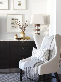 A muted color scheme doesn't have to be boring! The combination of fresh BEHR paint in Polar Bear white on the walls, cozy textures in the furniture, and charming accessories proves this to be true. Click here to find even more monochromatic design inspiration.