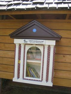 Alison Meltzer. Wilton, NH. This Little Library is maintained in partnership with the Wilton Main Street Association and the Wilton Public and Gregg Free Library. It was designed to look like the façade of the library building. It was beautifully crafted by a local furniture maker, and carefully hand-painted by a local artist. Our Little Free Library is mounted in our Main Street Park, where readers of all ages are invited to rest on a bench in the shade, and read a good book.