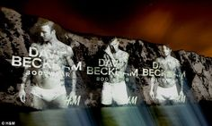 images of David Beckham in his famous barely-there briefs have been projected onto the White Cliffs of Dover to help welcome tourists flying into Britain
