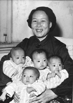 1960: Proud mother Liu Wan-Fu of Tientsin or Tianjin in China displays her 6-month-old quadruplets, a girl and three boys.