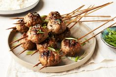 These skewered meatballs are a quintessential Japanese bar food¿a great drinking snack that can be turned into a larger meal with rice. Flavored with plenty of garlic and ginger and brushed with a sweet-and-savory soy glaze, these meatballs are a great de Easy Japanese Recipes, Asian Recipes, Ethnic Recipes, Ground Chicken Recipes, Ground Turkey Recipes, Japanese Chicken, Japanese Bar, Antipasto, Food On Sticks