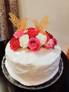Chiffon cake covered with Boiled Icing and filled with Strawberries & Cream (decorated with fresh roses)