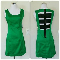 """NWT F21 green back zipper dress Green dress with back zipper detailing from Forever 21. Open back design with black elastic, provides some stretching. There are no rips or stains. Pair this with a chunky necklace and black pumps or throw a leather jacket over this for a night out.   Measurements: Pit-pit = 15.75"""" Waist = 26"""" Shoulder-bottom = 23.5"""" Forever 21 Dresses"""