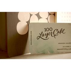 Blind embossing, letterpress, die-cut edges, and watercolor details for 100 Layer Cake business card.