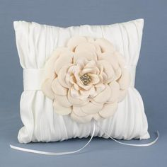 Ivory+satin+ring+pillow+decorated+with+a+champagne+flower+is+the+perfect+for+vintage+or+garden+themed+weddings.