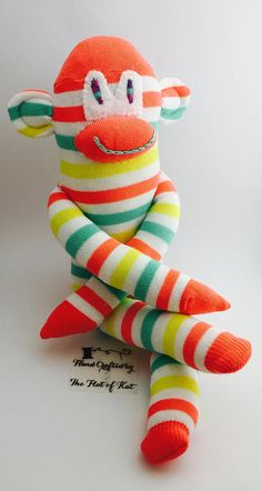 Striped sock Monkey handmade from brand new green, white , yellow and orange socks a perfect friend for any little boy or girl or a companion in the office or the car! He is 38cm in length from toe to top and weighs 84g his eyes are felt and his features are hand sewn with embroidery thread hes stuffed with super soft toy stuffing, All my sock monkeys are ce certified and suitable for any age He has friends that match: https://www.etsy.com/uk/listing/523818095/wh...