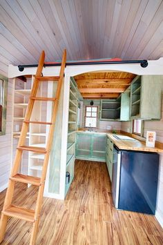 This Wishbone Tiny Home is a long custom built tiny house on wheels. Lovely teal and blues in this kitchen. Photo: Christopher Tack ( Tiny Homes Tiny House Plans, Tiny House On Wheels, Bungalows, Casa Loft, Tiny House Nation, Tiny House Movement, Tiny Spaces, Tiny House Living, Tiny House Design