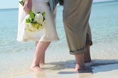 Hydrangeas are a popular choice for beach wedding bouquets.  Photo by Sunset Beach Weddings.