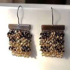 Milena Zu earrings with beautiful Swarovski beads in black and gold.