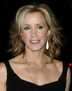 Felicity Huffman takes a classic short long hairstyle and makes it full and bouncy with waves and gorgeous highlights that are lighter around the face.More about hair for older women:Hair Over 40Hair Over 50Hair Over 60