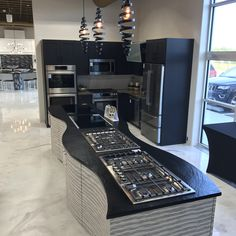It's easy to match countertops with backsplashes, but don't forget about the flooring! This kitchen's use of Vulcano Quartz and black appliances against a light-colored floor really pops! Kitchen Cabinets, Kitchen Appliances, Black Appliances, Quartz Countertops, It's Easy, Backsplash, Don't Forget, Flooring, Home Decor