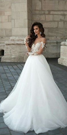 Love the off the shoulder lace top on this ballgown!