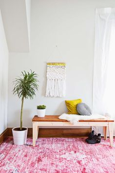 Beautiful DIY Bench Tutorials Roundup | We've got ideas for woodworkers, seamstresses, IKEA hackers, and more! For an organized entryway bench, or a bedroom bench at the foot of your bed, these project ideas are perfect for narrow spaces.
