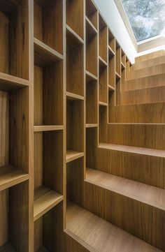 Nice bookshelf stairway awaiting copies of #Booktrope editions. I want! |Pinned from PinTo for iPad|