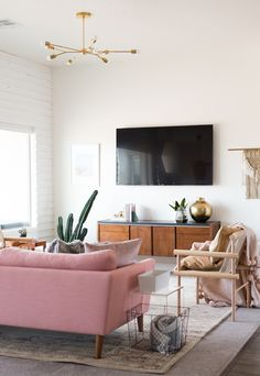 Pink sofa and brass ceiling light