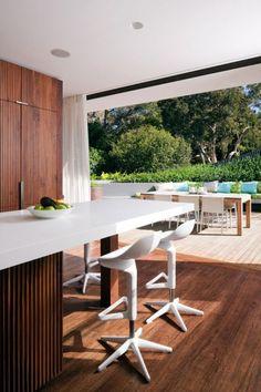 wood + white in the kitchen + garden view