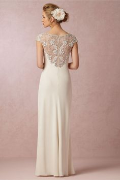 Avalon Gown from BHLDN-- Vintage glamour meets modern beauty, this silk gown from Ranna Gill is embellished with tiny sequins and countless beads at the neckline and cap-sleeves, then gives way to an incredibly flattering bias-cut silhouette that subtly highlights your figure and a sheer, beaded back. A sophisticated choice that we love paired with sparkly heels. Back zip.