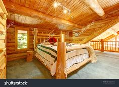 stock-photo-log-cabin-bedroom-under-wood-large-ceiling-with-queen-size-bed-100647073.jpg (1500×1100)