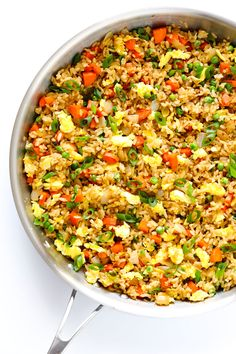 The BEST homemade fried rice recipe!! It only takes 15 minutes to make, it's easy to customize with your favorite add-ins (like chicken, pork, beef, shrimp, tofu, and/or vegetables), and it is SO flavorful and delicious! Way better than any Chinese takeout I've ever tried. ;) | gimmesomeoven.com