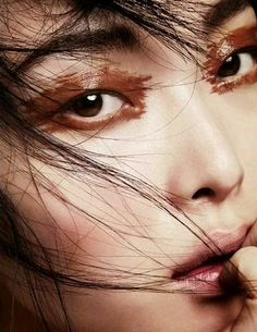 Magazine: Vogue China October 2013 Title: The Eyes Have It Photographer: Marcus Ohlsson Model: Sung Hee Kim Stylist: Stevie Dance Make up: Fredrik Stambro Hair: Miki at Tim Howard