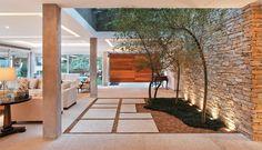 Uma casa que integra as áreas de lazer às áreas de estar - Casa