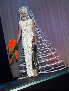 The Caged Bride And after the couple gets hitched, she can guarantee her hubby won't stray by keeping him in her veil.