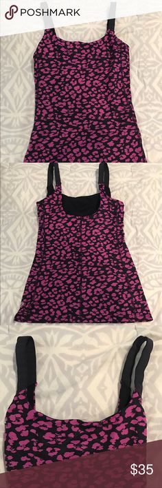 Lululemon Black and Purple Cheetah Printed Tank Lululemon Black and Purple Cheetah Printed Tank. Top is in great/like new condition. It has a built in bra (not very supportive) and is form fitting. Top is in basically new condition (no marks, pulls, etc). There are no size markings on the top, but to the best of my ability I would say this is a size 4 top. lululemon athletica Tops