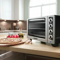 The KitchenAid® Countertop Toaster Oven offers a spacious capacity which easily accommodates up to two 12-inch pizzas.