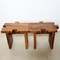 @Overstock.com - This puzzle piece stool or unique end table, can also be joined together to form benches or larger tables. The hand-carved furniture boasts a natural chestnut oil finish.http://www.overstock.com/Worldstock-Fair-Trade/Hand-carved-Wooden-Puzzle-Piece-Stool-Thailand/6555481/product.html?CID=214117 $134.99