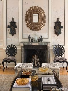 chairs as place holders on sides of fireplace