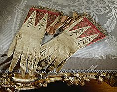 Red and green Ceremonial gloves of Queen Elizabeth I of England (1558-1603).