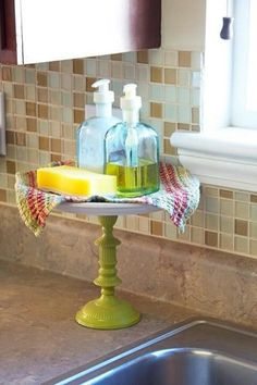 Use a cake stand to hold soap and sponges by the sink instead of them being on the counter!