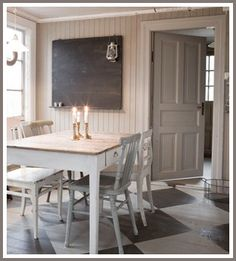 Kitchen dining area with a great painted floor. Diamonds are a kitchen's best friend.