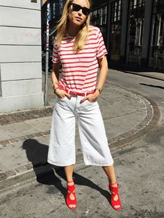 Pernille Teisbaek wears a striped t-shirt with belted denim culottes and red accessories
