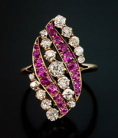 An Antique Pink Sapphire and Diamond Swirl Ring - This Belle Epoque ring was made in St. Petersburg between 1899 and 1904. 14K yellow gold, eighteen natural pink sapphires (approximate combined weight 1.25 ct) , seventeen old cut diamonds (approximate total weight 1.5 ct).