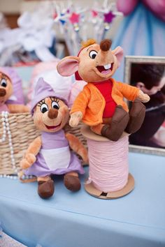 Buy some baskets, chalk, pink and or white ribbon, some yarn, pair of scissors, pearls and spools of thread from dollar tree or 99cent store and add any mice character of choice or add a printable picture of Jaq and Gus