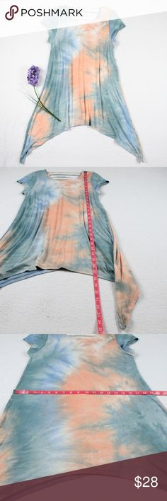 NEW Blue Peach Tie Dye Stretchy Long Tunic Top New with tags. Blue and Peach colored long tunic. Longer on sides. Caged Back detail Very comfortable. Perfect top to use as a beach cover up or a casual top. Pairs well with white shorts/capris or your favorite light wash denim.  95% Rayon, 5% Spandex Please see photos for measurements.  Feel free to make an offer via offer button only. NO TRADES Boutique Tops Peach Tie, Blue Peach, Blue Orange, Boutique Tops, Ladies Boutique, Long Tunic Tops, Beach Covers, New Blue, Casual Tops