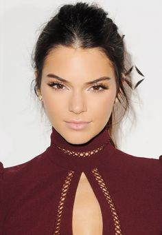 Kendall Jenner kept her hair and makeup simple with long, full lashes