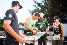 Portland Timbers midfielder Eric Alexander (17), goal keeper Joe Bendik (23), and Timber Joey volunteer with Alaska Airlines at Habitat for Humanity for Stand Together Week on October 9, 2012 in Portland, Oregon. (L.M. Parr/Portland Timbers)