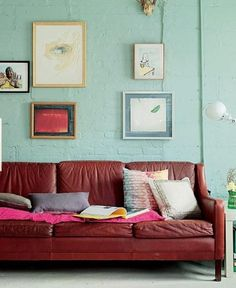 mint green walls.  Surprisingly looks really good, we have this same color leather couch, I would never have considered mint green before.