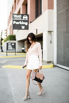 Get the sophisticated look by trying a sharp and tailored short with a long-sleeved blouse.