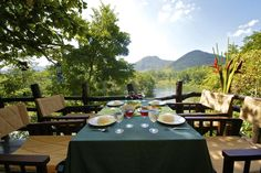 """The semi open-air dining is set on wooden terrace overlooking the historical river """"Kwai Noi"""". Admire spectacular landscapes while savoring a delicious and tasty bite cooking."""