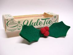 This is your chance to make a fashion statement this holiday season with the Yule Tie! Vintage felt bowtie in the form of holly leaves and