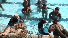 U.S. Marines and Australian soldiers conduct shallow water egress training during Exercise Rim of the Pacific 16 (RIMPAC 16) ... a multinational maritime exercise that takes place in and around the Hawaiian Islands.
