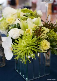 Green spider mums,brunia,green hydrangea,natural green roses in a mirrored  art deco  style container.