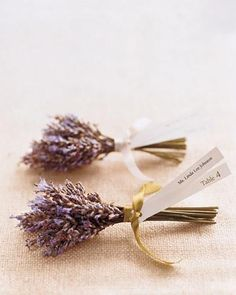 For an aromatic seating card, two strips of paper -- with the guest's name printed on one end and the table number on the other -- are tied with satin ribbon to lavender wrapped with floral tape.