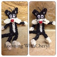 Rainbow loom figures Sylvester The Cat (Looney Tunes). Charms. Designed and loomed by Cheryl Spinelli. 4/24/14. I used DIYMommy's pig ears.